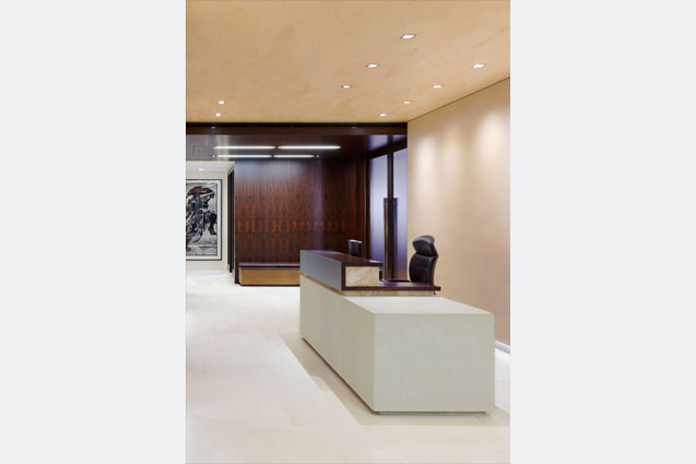 Main reception area with leather walls and ziricote wood paneling
