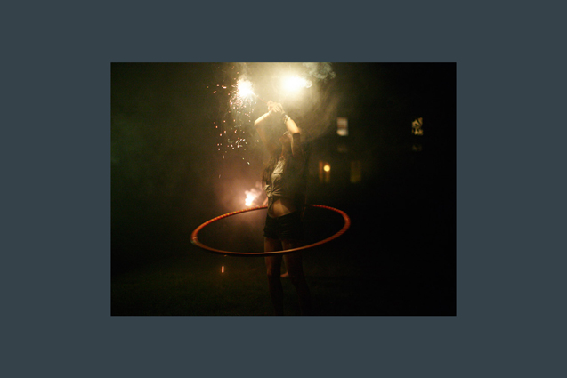 girl with hula hoop and sparkler