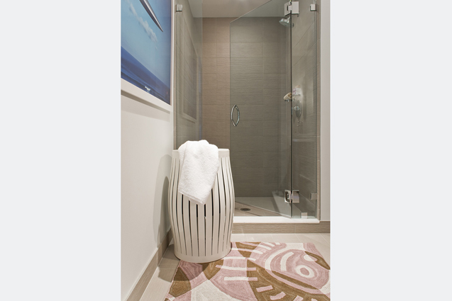 master bathroom shower with hamper
