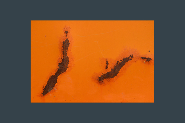 orange background with two rust gashes
